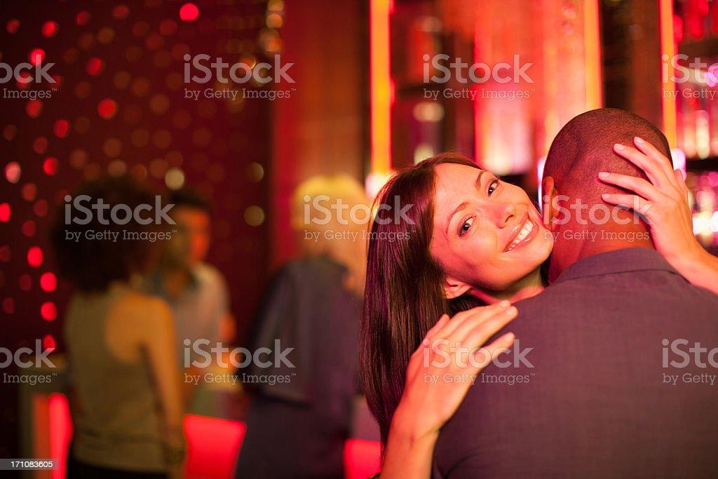 Couple hugging in nightclub stock photo