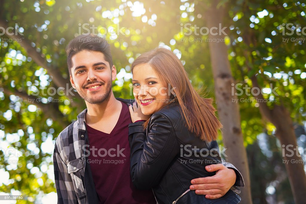 Couple hugging in the park. selective focus stock photo