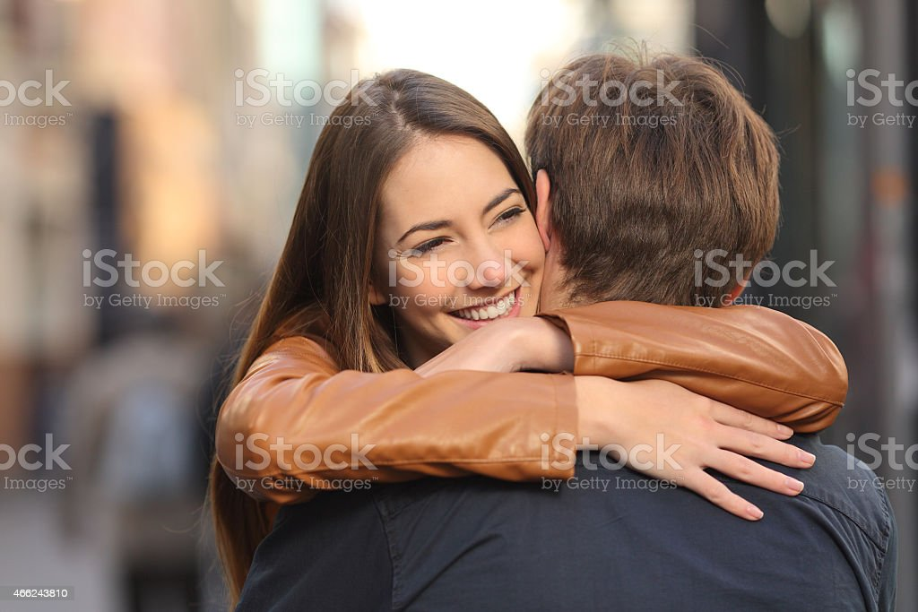 Couple hugging in the street stock photo