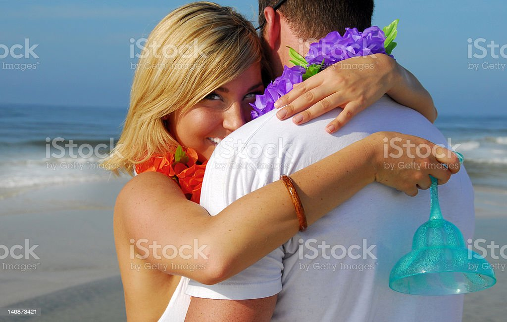Couple hugging on beach royalty-free stock photo