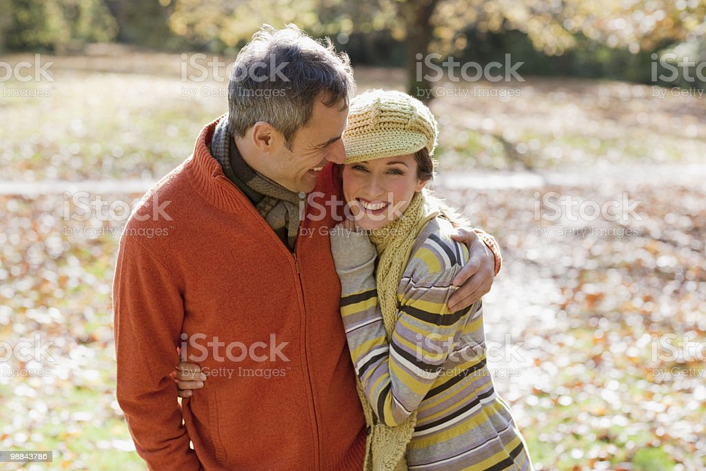 Couple hugging outdoors in autumn royalty free stockfoto