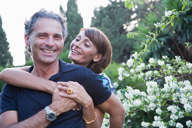 Couple hugging outdoors stock photo