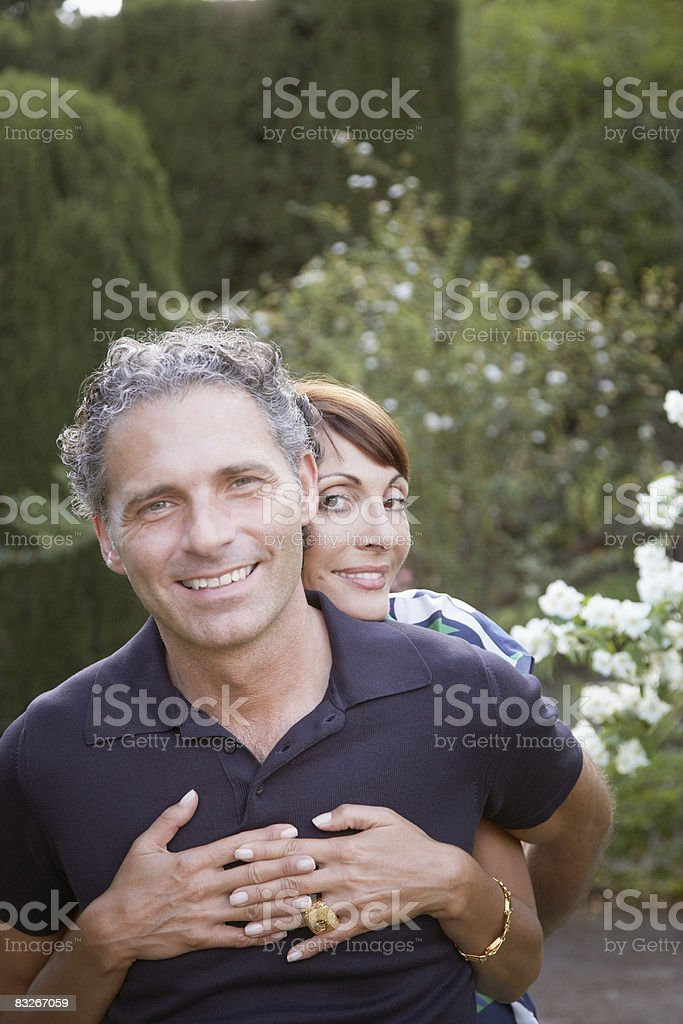 Couple hugging outdoors royalty-free stock photo