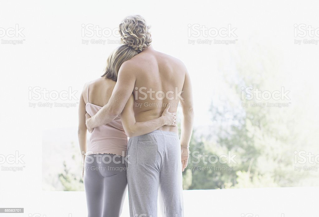 Couple hugging outdoors 免版稅 stock photo