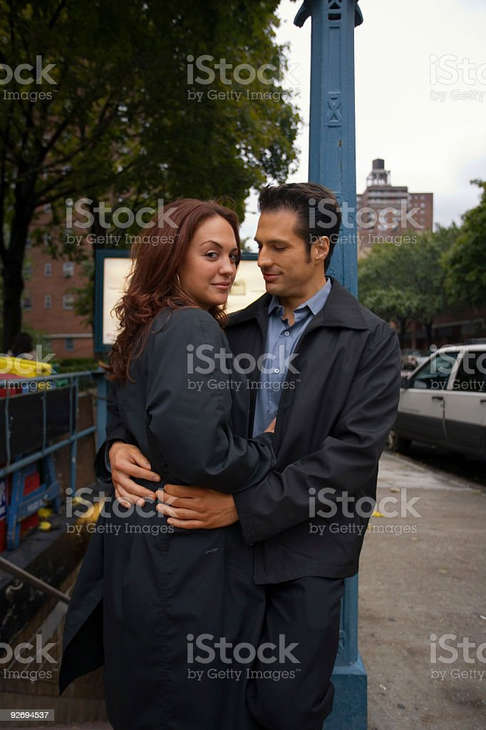 Couple hugging outside a subway entrace royalty-free stock photo