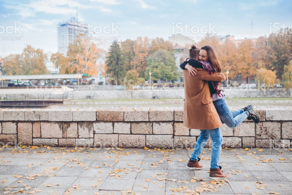 Couple hugging passionately by the river stock photo