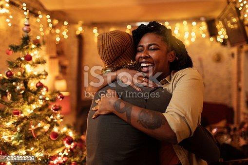 Couple hugging on Christmas eve
