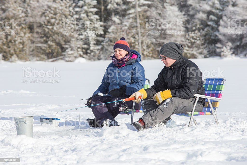 Couple ice fishing stock photo