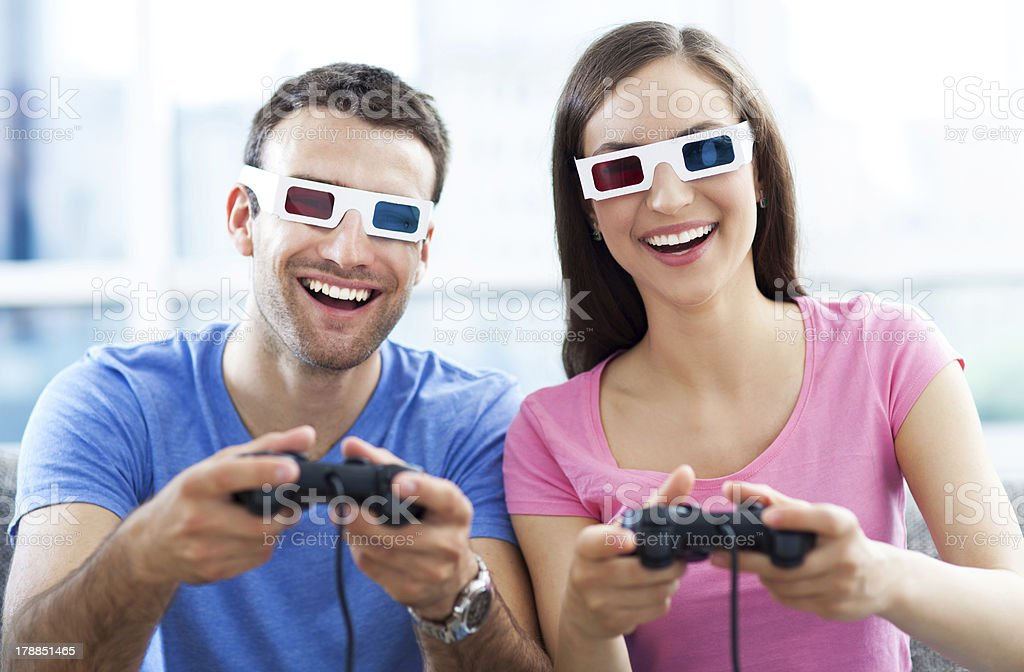 Couple in 3d glasses playing video games royalty-free stock photo
