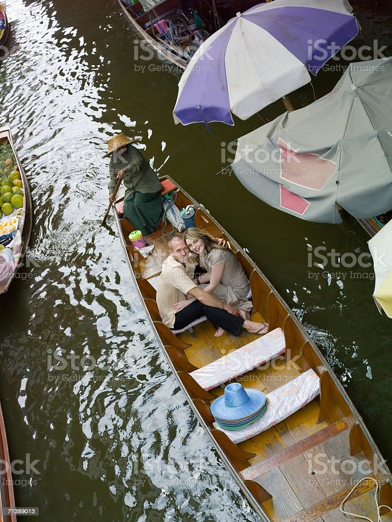 Couple in a boat by floating market royalty-free stock photo