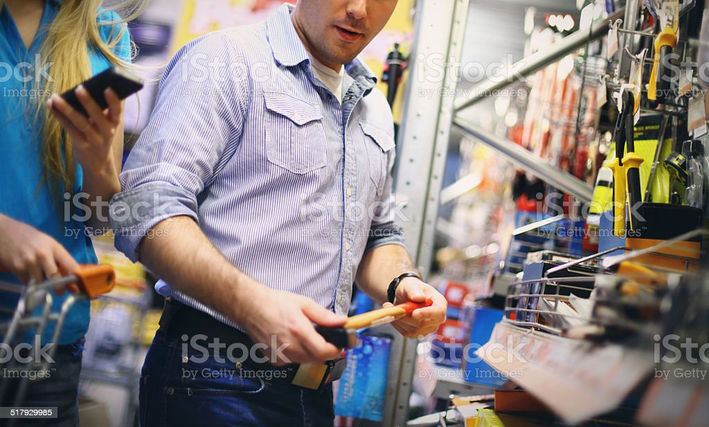 Couple in a hardware store. stock photo