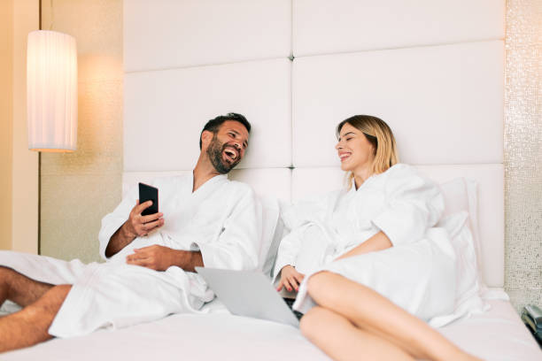 Couple in a hotel room stock photo
