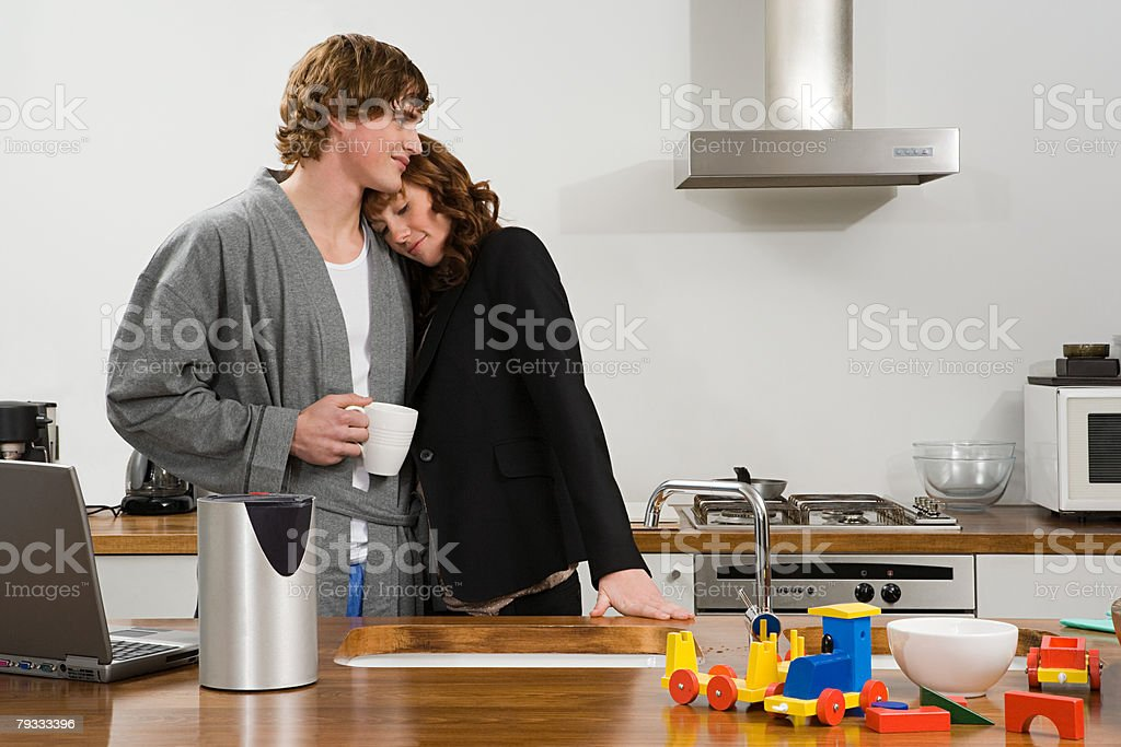 A couple in a kitchen royalty-free stock photo