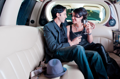 Couple In A Limo Stock Photo - Download Image Now