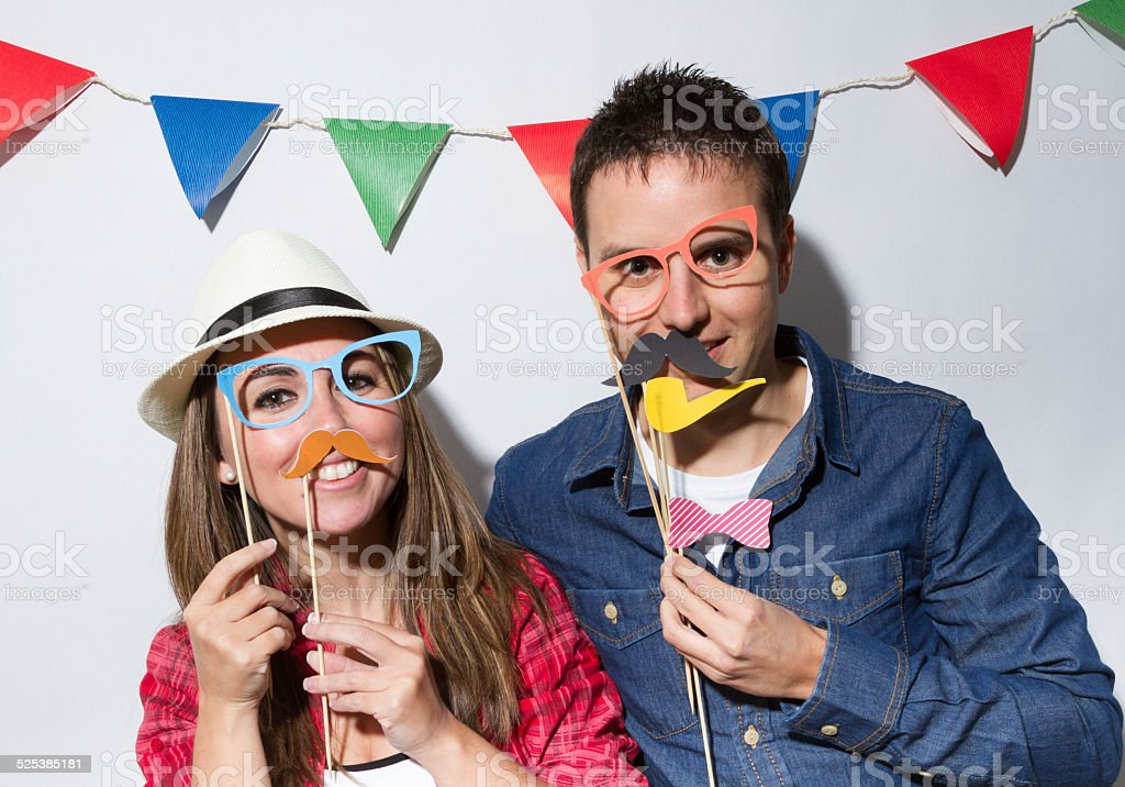 Couple in a Photo Booth party stock photo
