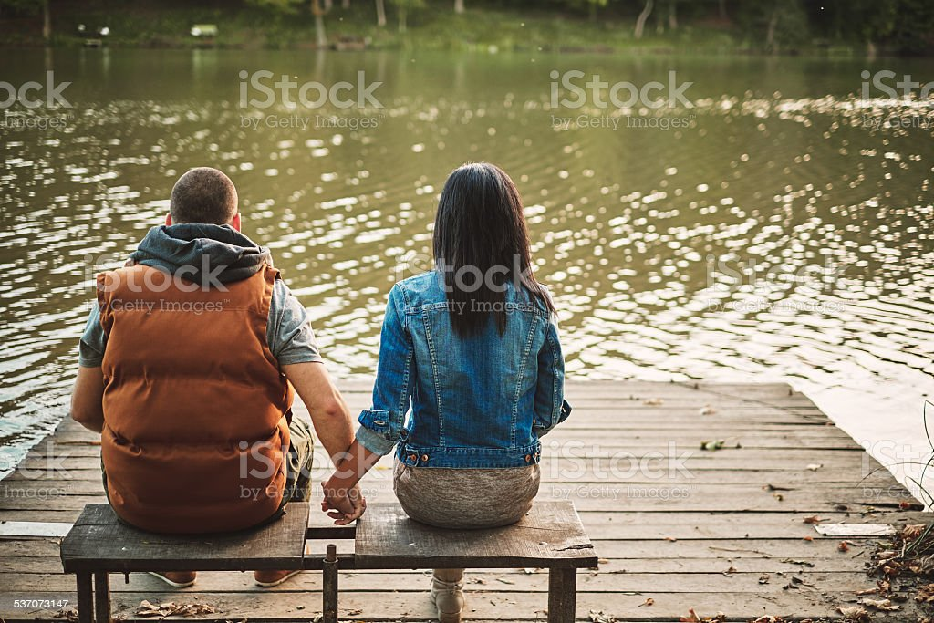 Couple in a pier stock photo