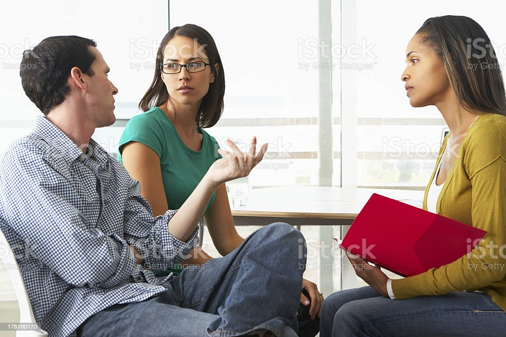 Couple in a relationship counseling session with a therapist stock photo