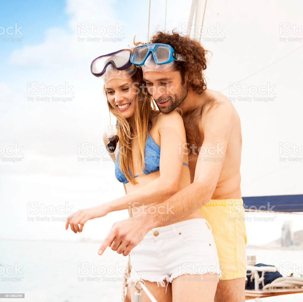 Couple in a sailing boat preparing for snorkel royalty-free stock photo