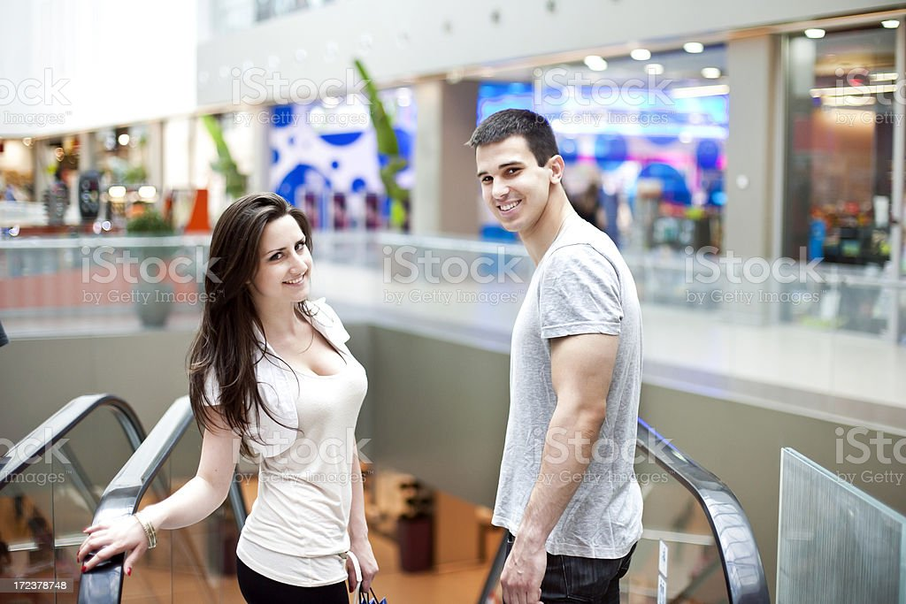 Couple in a shopping mall escalator royalty-free stock photo