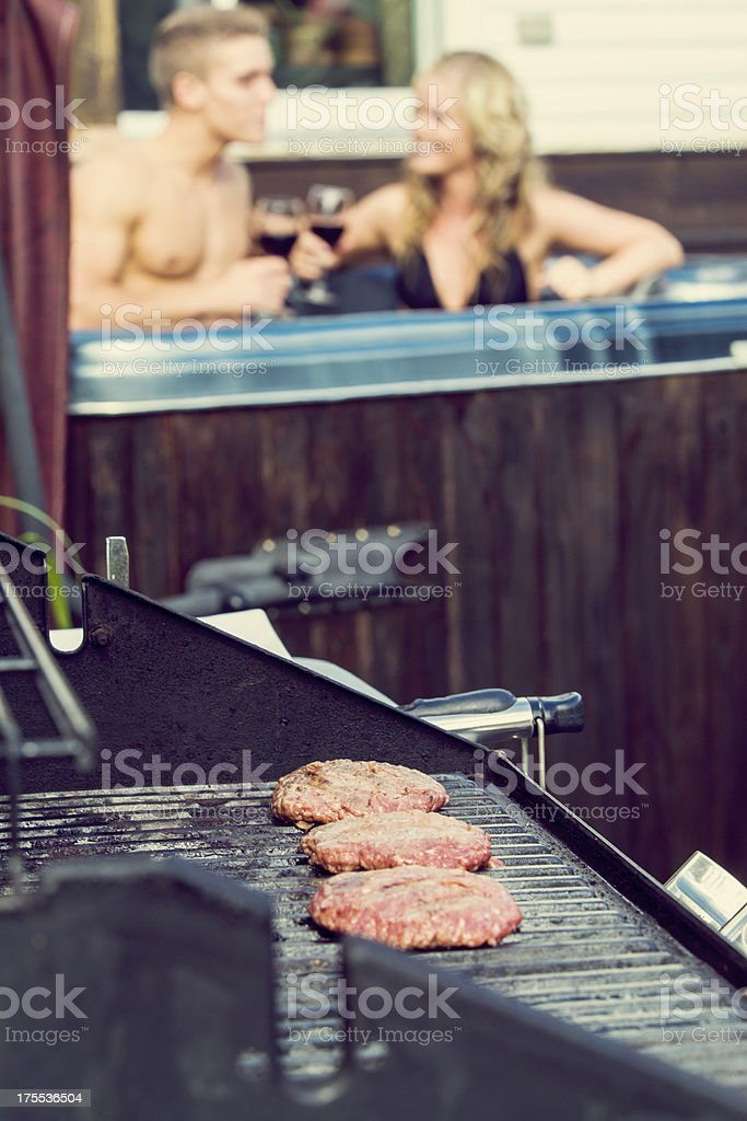 couple in a spa with barbecue grill stock photo
