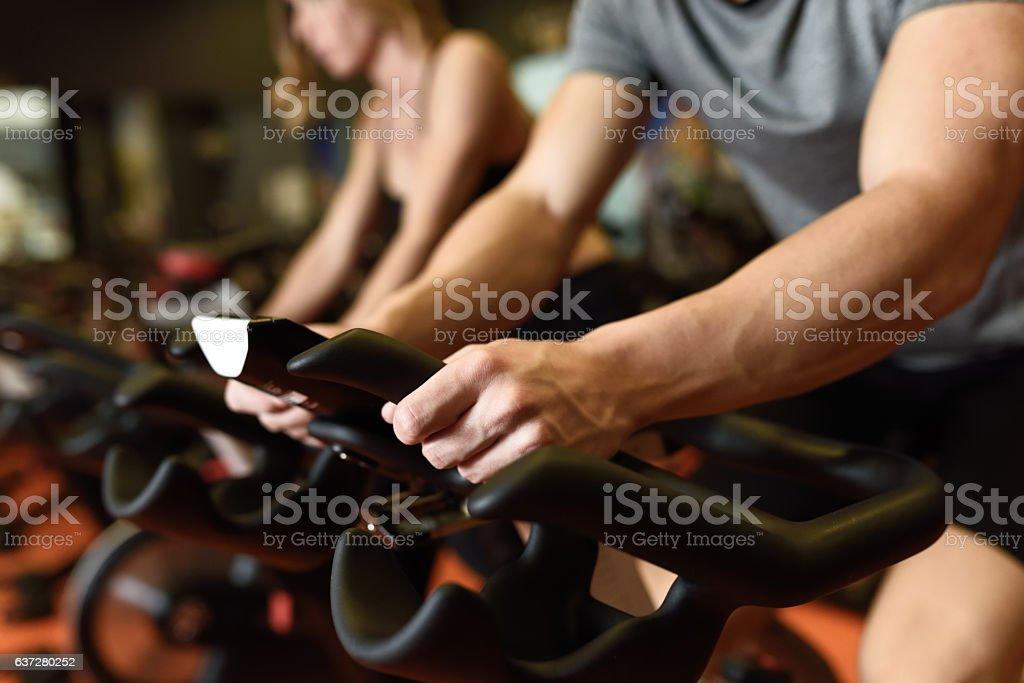 Couple in a spinning class wearing sportswear. stock photo