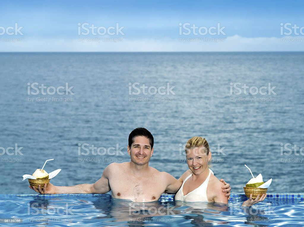 couple in a swimming pool royalty-free stock photo