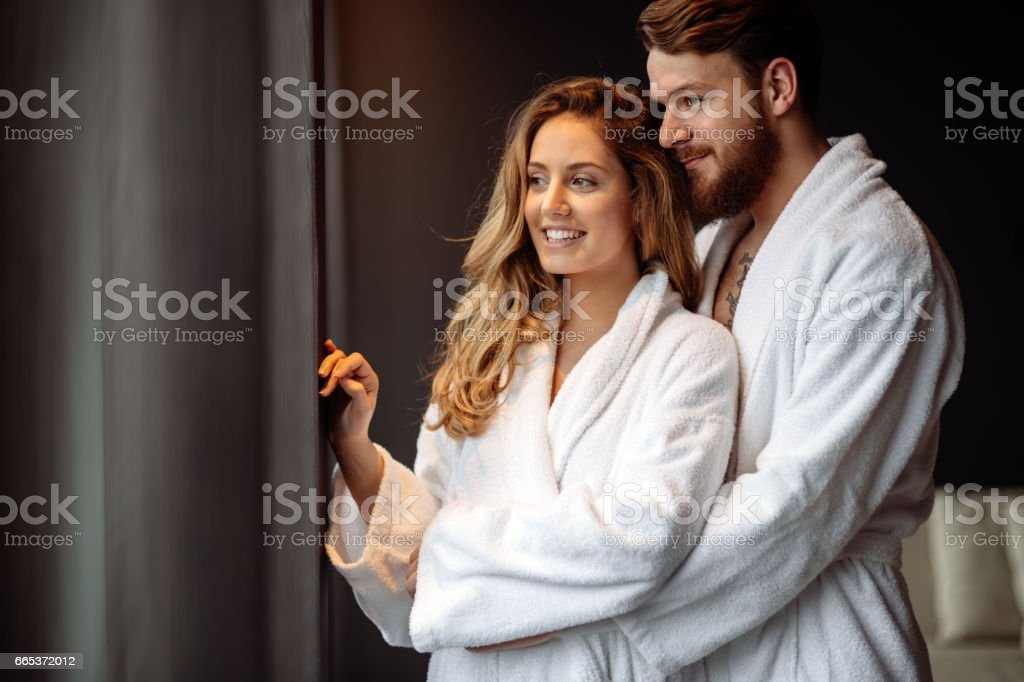 Couple in bathrobes enjoying honeymoon in spa resort - foto de stock
