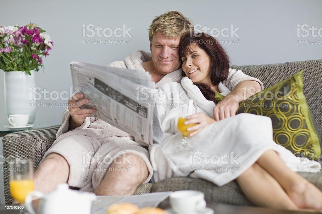 Couple in bathrobes having breakfast stock photo