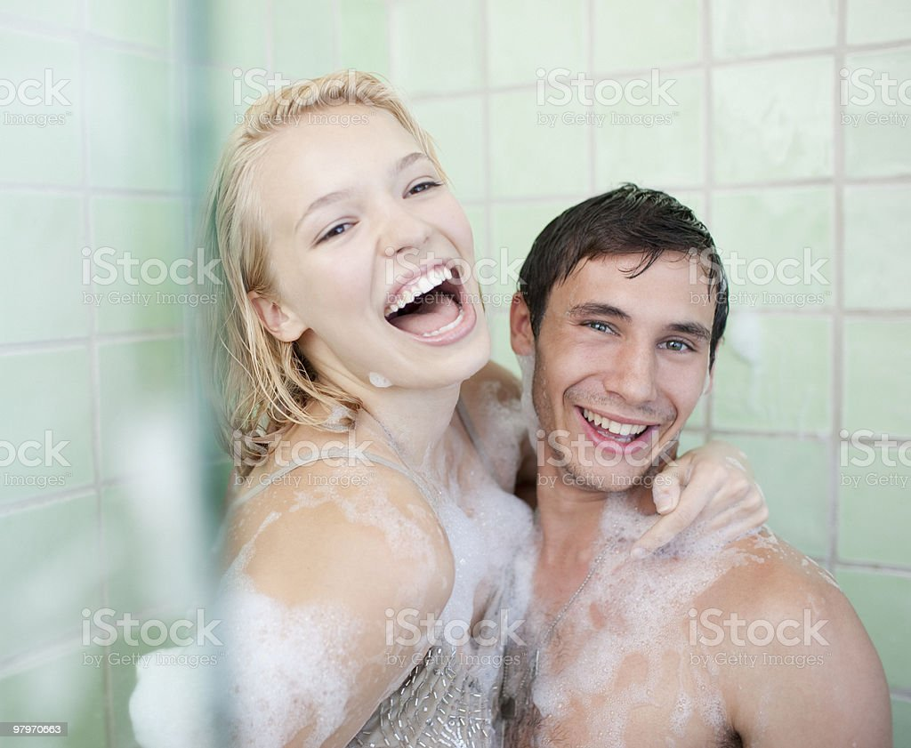 Couple in bathtub covered with soap suds royalty-free stock photo