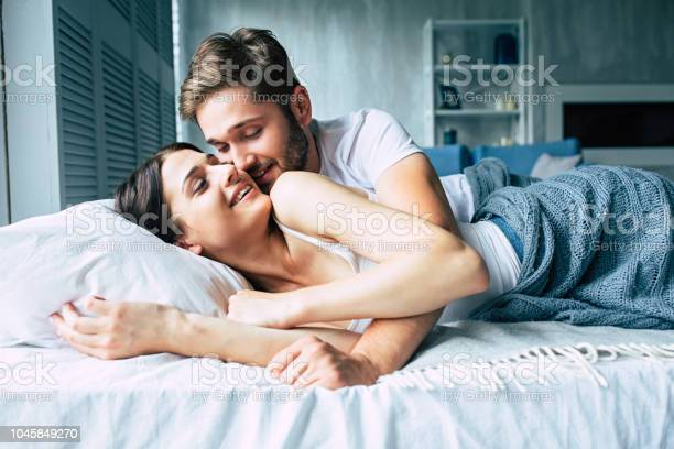 Couple in bed at home are kissing each other picture id1045849270?b=1&k=6&m=1045849270&s=612x612&h= 87voe6lzlmcvgyzjveyhzhfwmmhg9wldooelahr2fi=