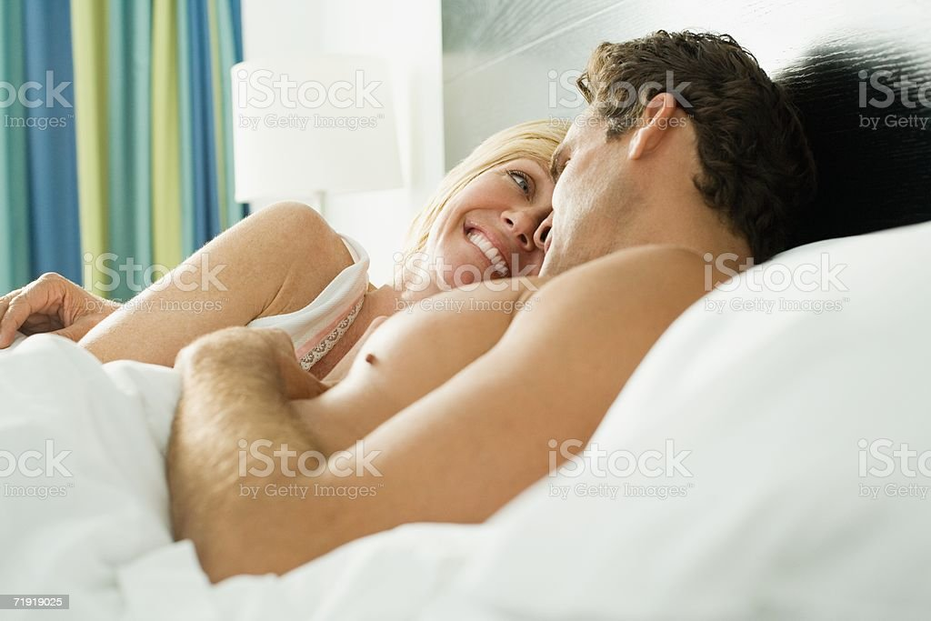 A couple in bed royalty-free stock photo