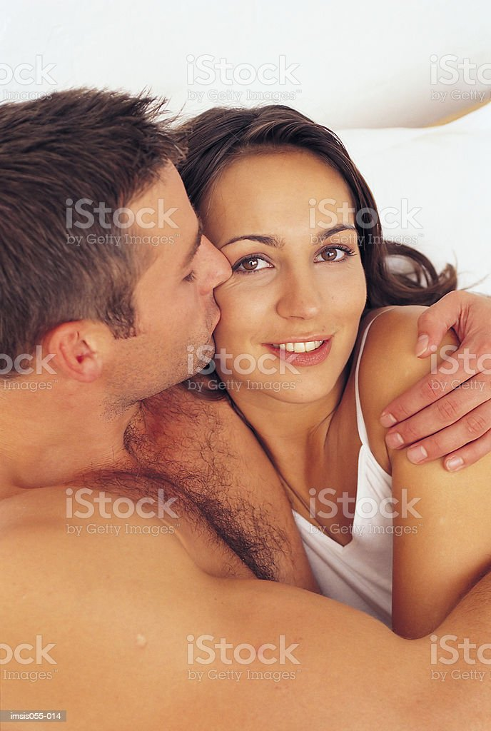 Couple in bed royalty free stockfoto