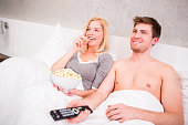 istock Couple in bed watching tv 174967833