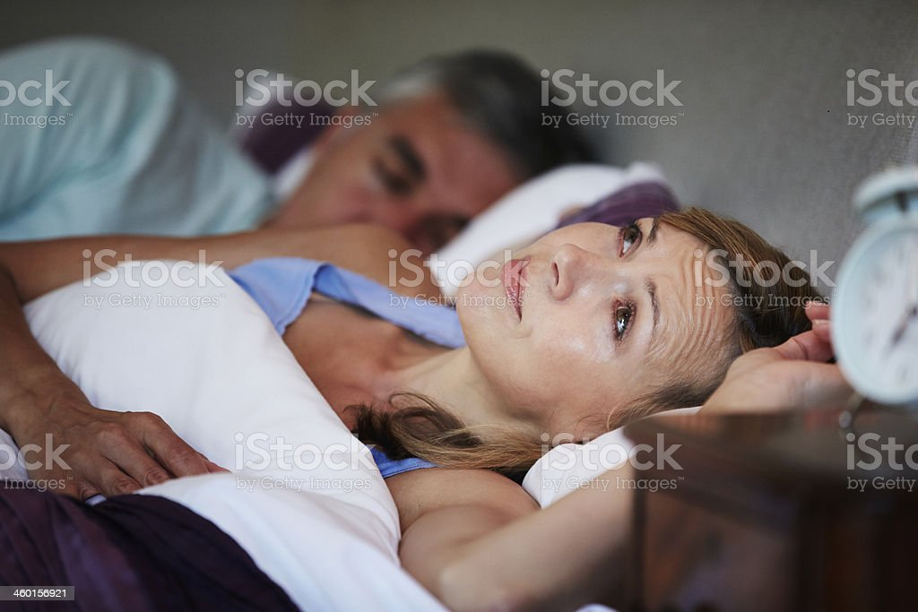Couple In Bed With Wife Suffering From Insomnia stock photo