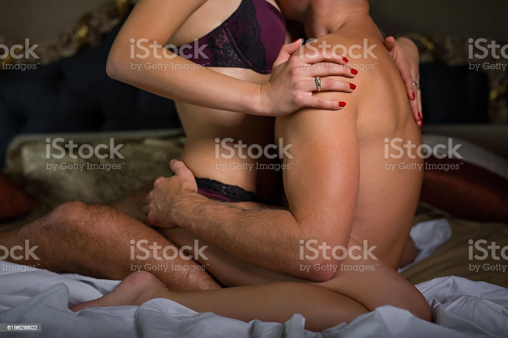 Couple in bedroom making love stock photo