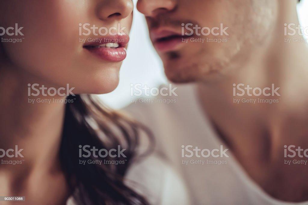 Couple in bedroom. stock photo
