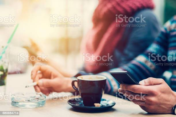 Couple in cafe texting picture id680684714?b=1&k=6&m=680684714&s=612x612&h=rt m7qlrokry3 0x5v zlgzdowkplvck3583nmyzrss=