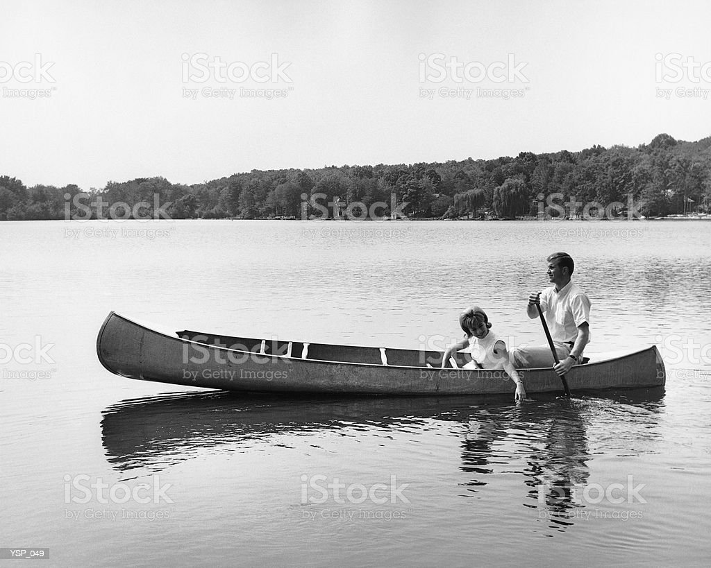 Couple in canoe on lake royalty-free stock photo