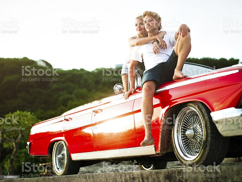 Couple in car watching sunset royalty-free stock photo