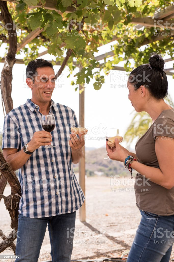 A couple in casual clothing having wine stock photo