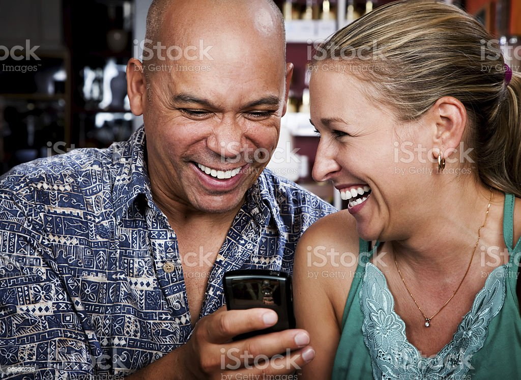Couple in Coffee House with Cell Phone royalty-free stock photo