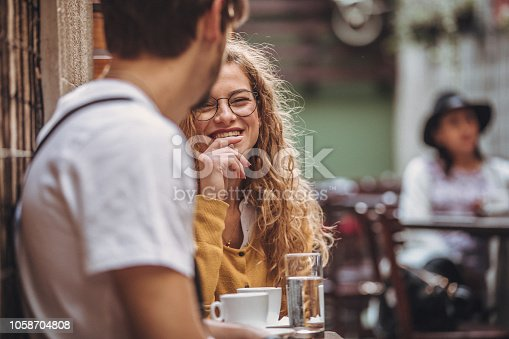 Young couple sitting in coffee shop