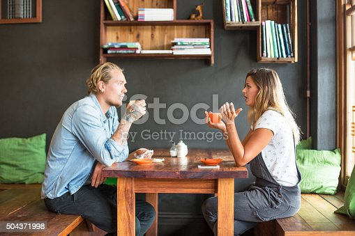 Hipster couple meet over coffee