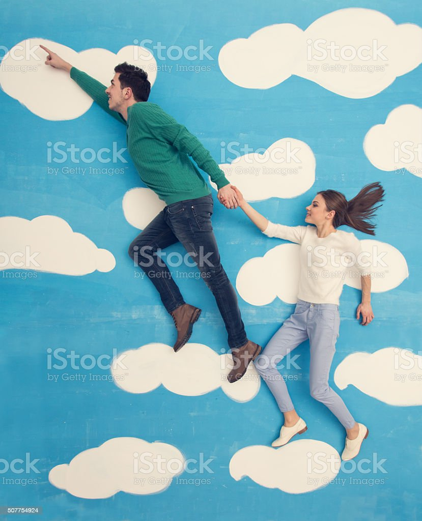 Couple in comic book: running in the clouds stock photo
