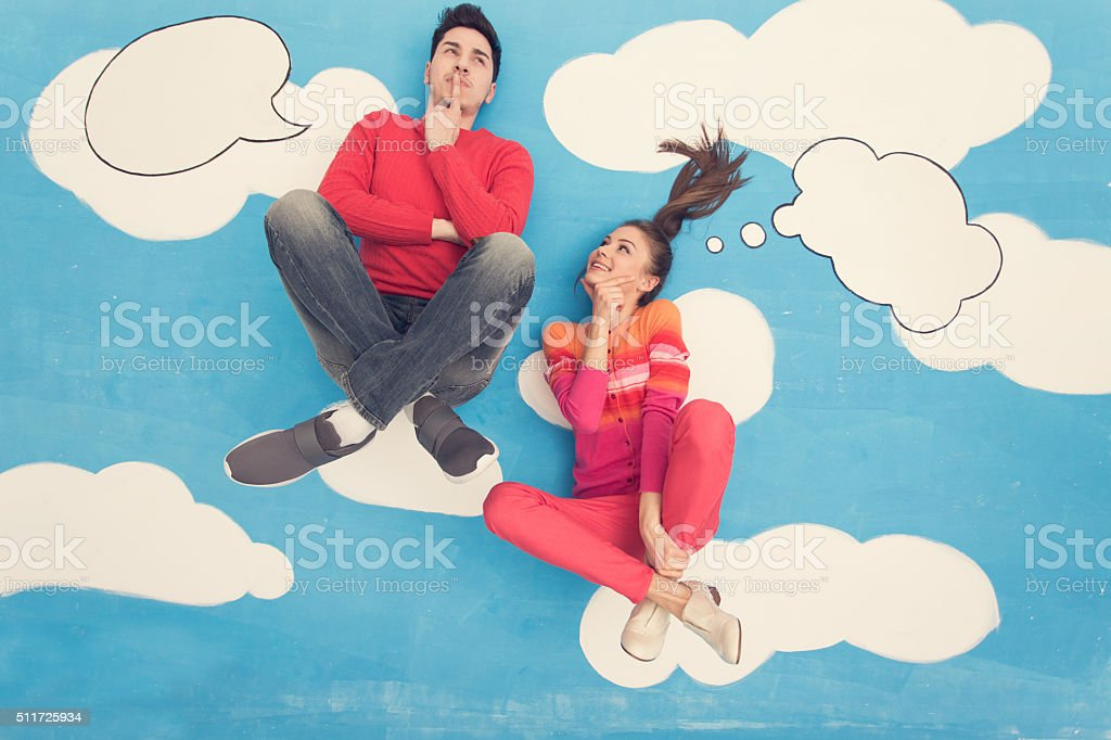 Couple in comic book: Sitting on clouds, thinking stock photo