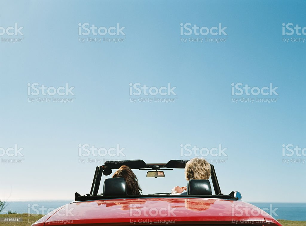 Couple in convertible stock photo