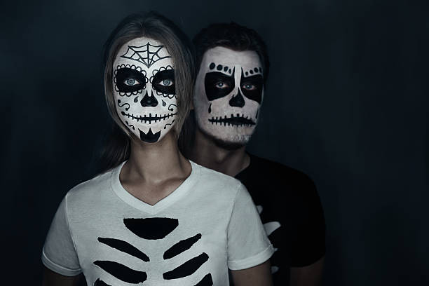 Couple in costumes of skeletons picture id530299667?b=1&k=6&m=530299667&s=612x612&w=0&h= kwgexor6n0bgbp1unv8fjno4pjwjlkmzvd6s 5f4cc=