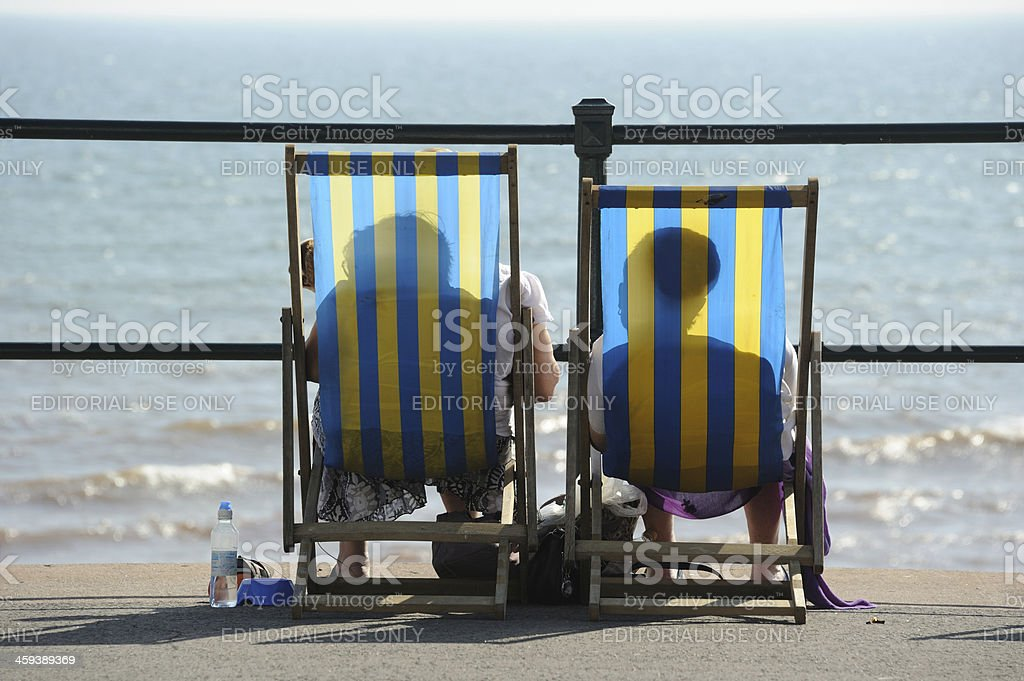 Couple in Deckchairs stock photo