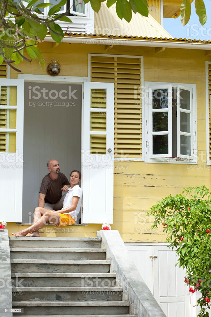 couple in doorway of yellow old house royalty-free stock photo
