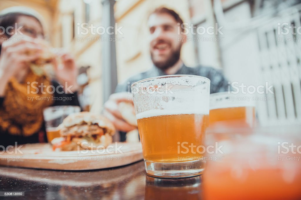Couple In Fast Food Restaurant stock photo